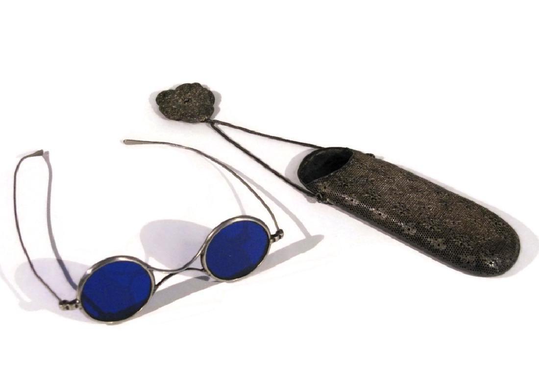 EYEGLASS HOLDER ON CHATELAINE & BLUE LENS GLASSES