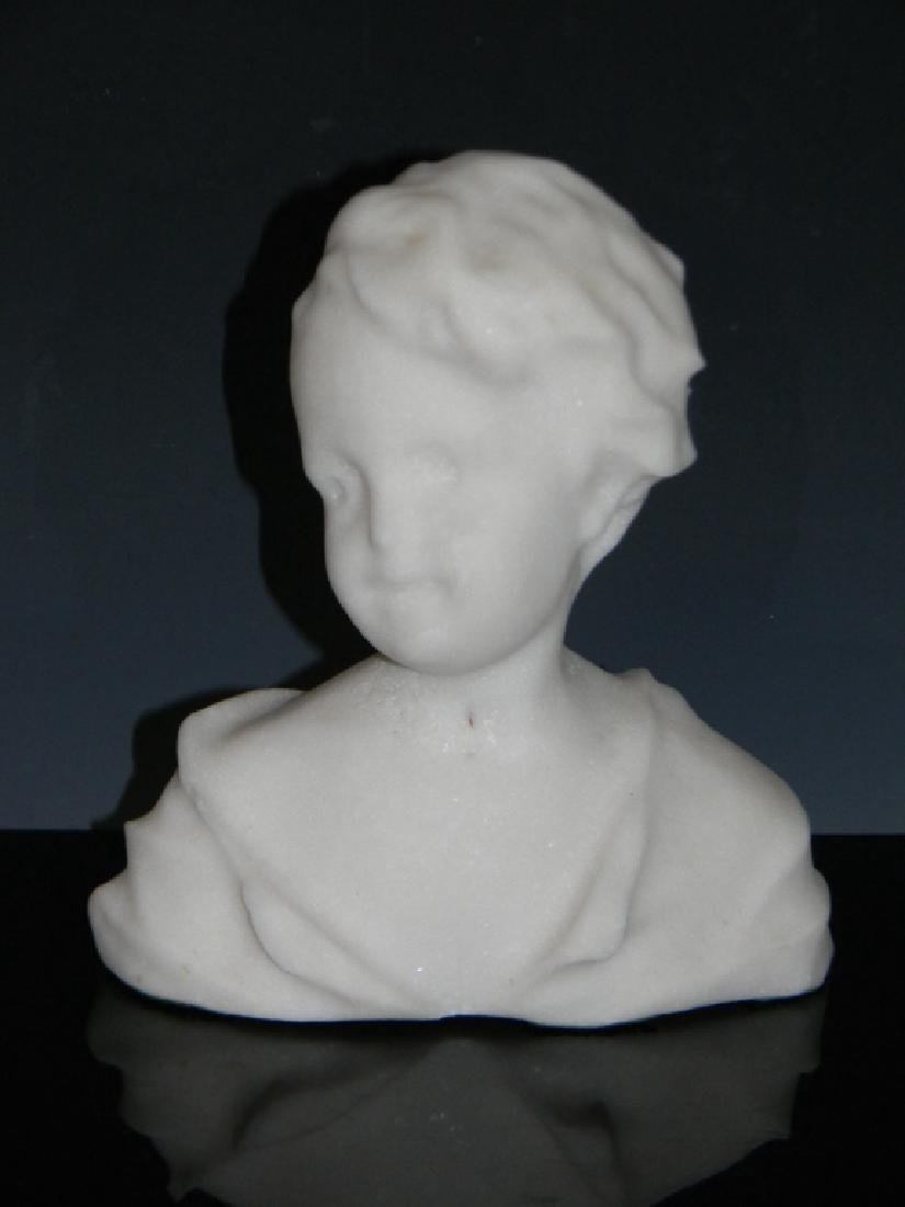 CAST MARBLE BUST OF A LAUGHING CHILD