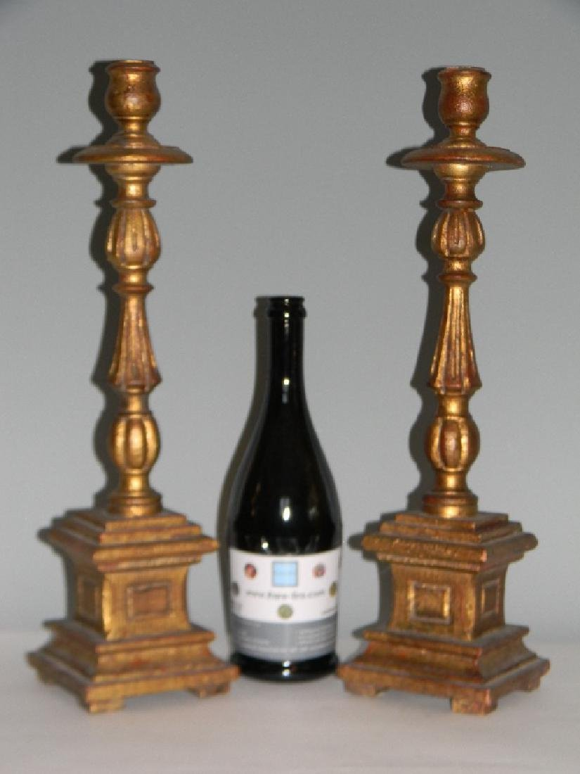 "PAIR CARVED AND GILDED WOOD CANDLESTICKS 18.5""H - 2"