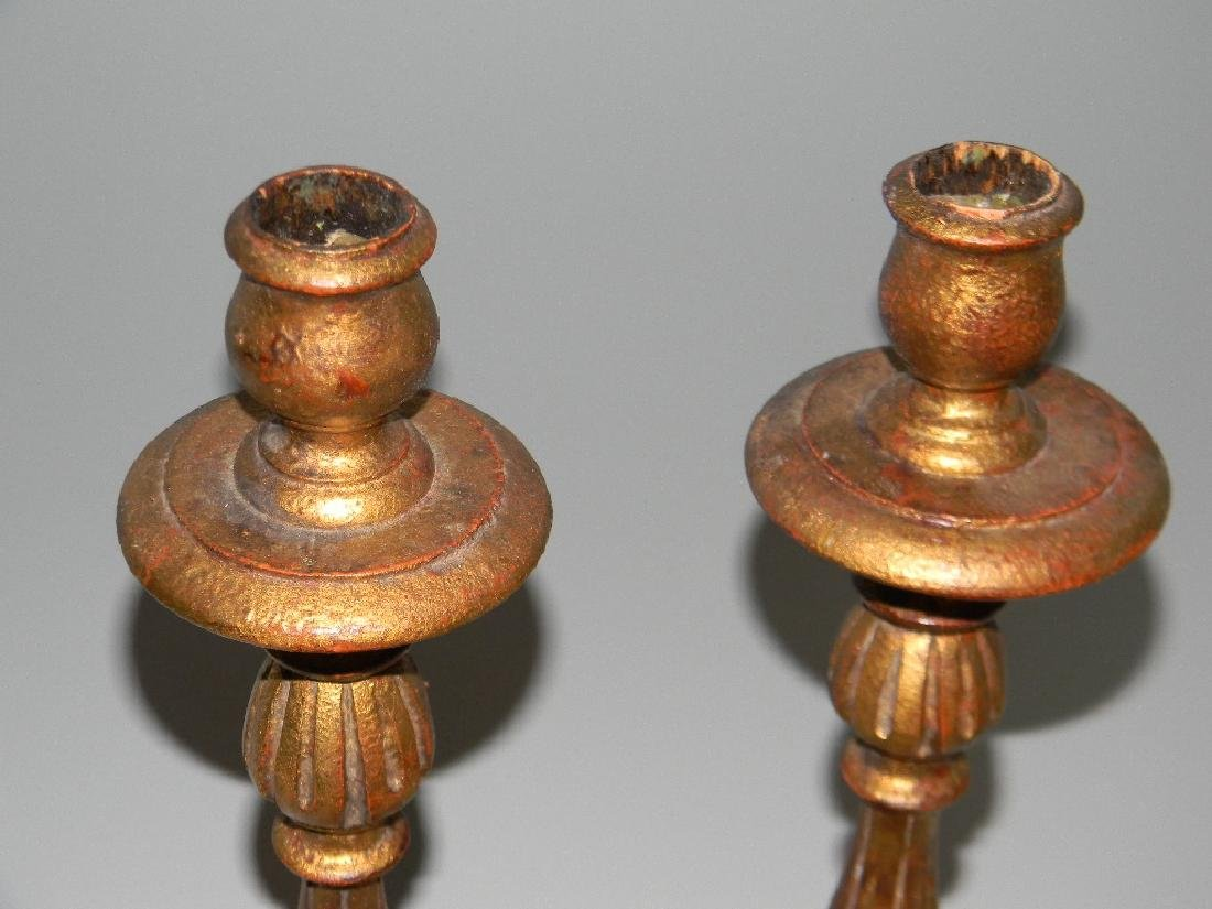"PAIR CARVED AND GILDED WOOD CANDLESTICKS 18.5""H - 3"