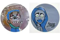 PAIR OF GRAFFITI PORTRAITS ON RECORD ALBUMS