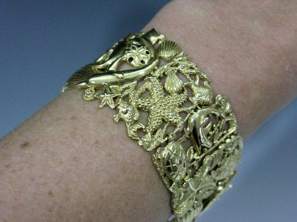 BRACELET 14K GOLD WITH FISH, SHELLS, DOLPHINS 52 g