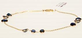 14k Gold Bracelet With Bezel Set Blue Sapphires