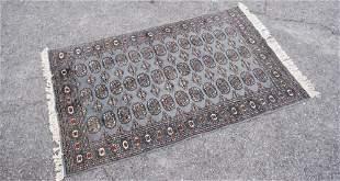 Vintage Blue Ground Persian Bokhara Carpet