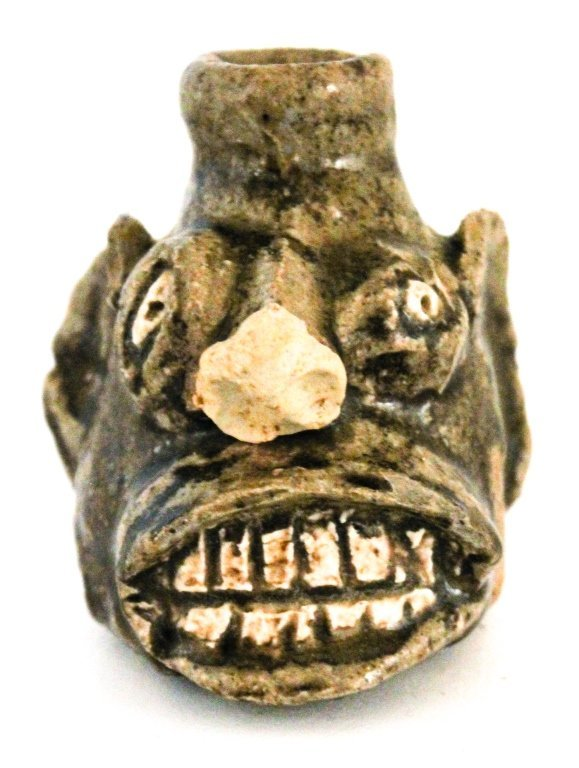 Very rare diminutive stoneware face jug