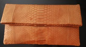 $850 BSABLE BROWN SNAKESKIN CLUTCH