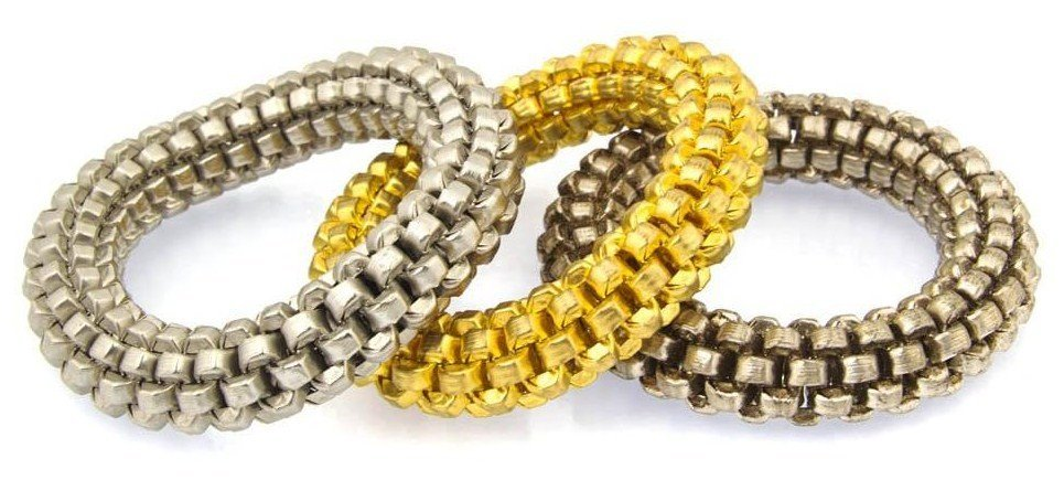 A Group of Three Goldtone & Silvertone Bangle Bracelets