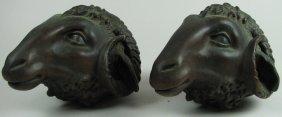Pair of Cast Bronze Ram Heads