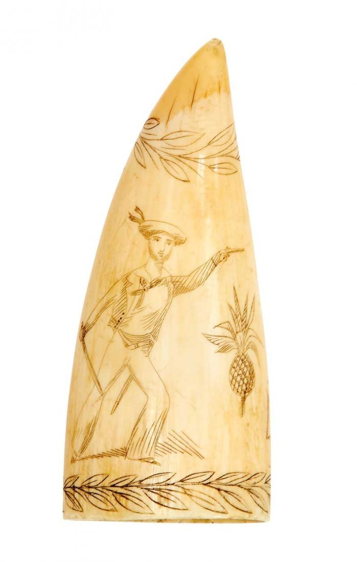 Ø A 19TH-CENTURY SAILOR'S SCRIMSHAW DECORATED WHALE'S