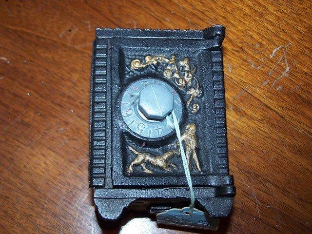 Vintage Cast Iron Medal Coin Bank Safe