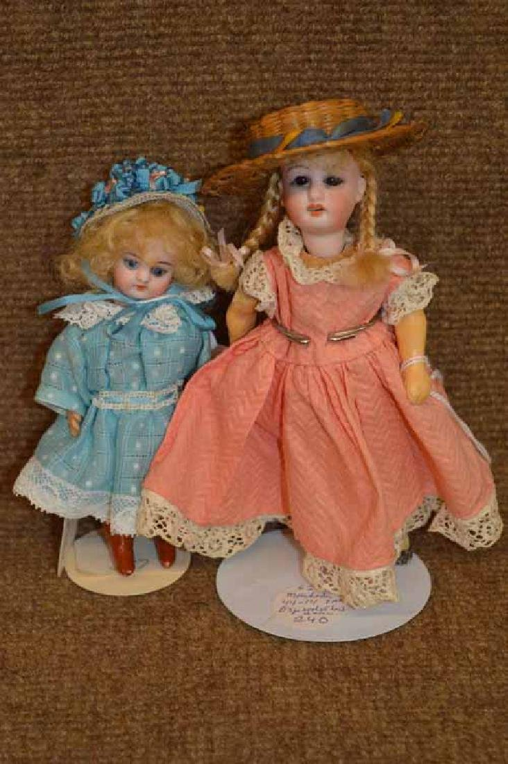 2 Small Bisque Head Dolls on Compo Bodies.