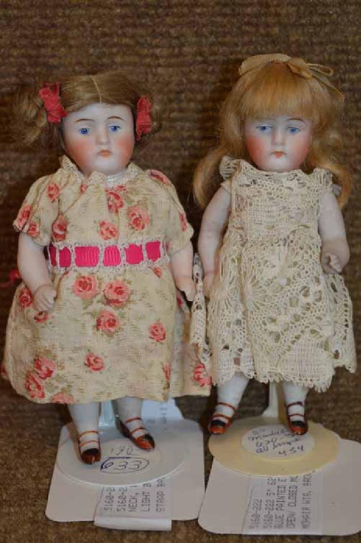 2 All Bisque Dolls