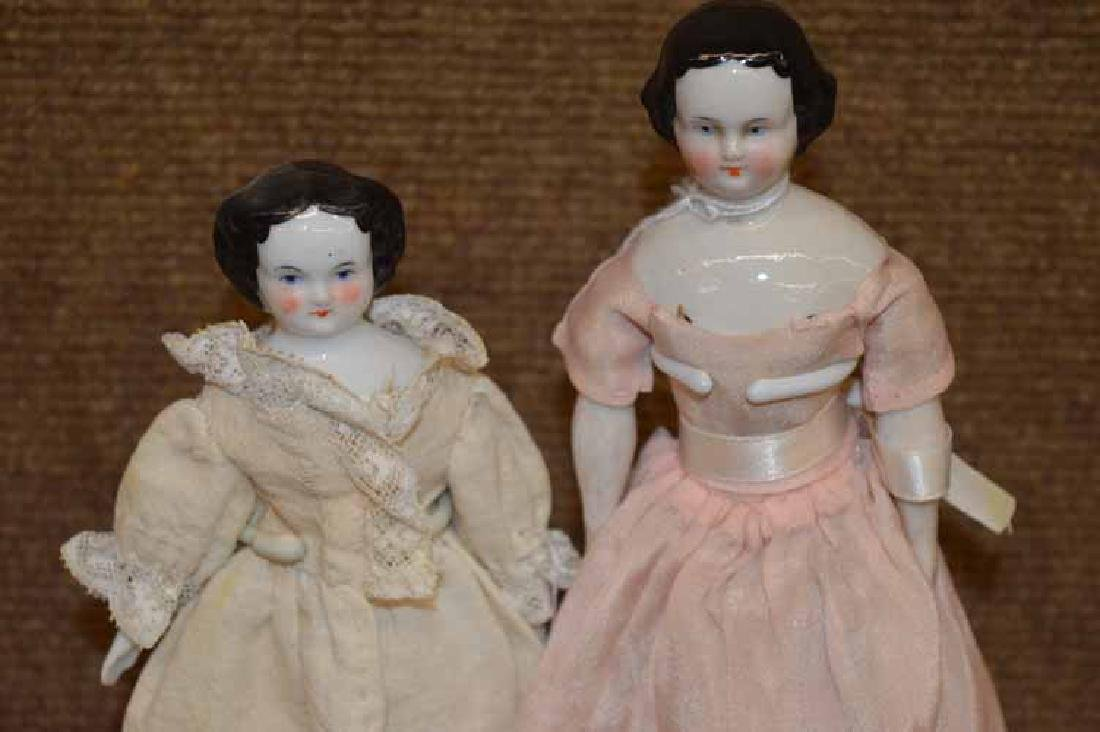2 Small Black Haired High Brow China Head Dolls