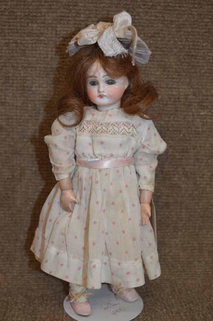 """9 1/4"""" Solid Dome Flat Neck Bisque Head Doll"""