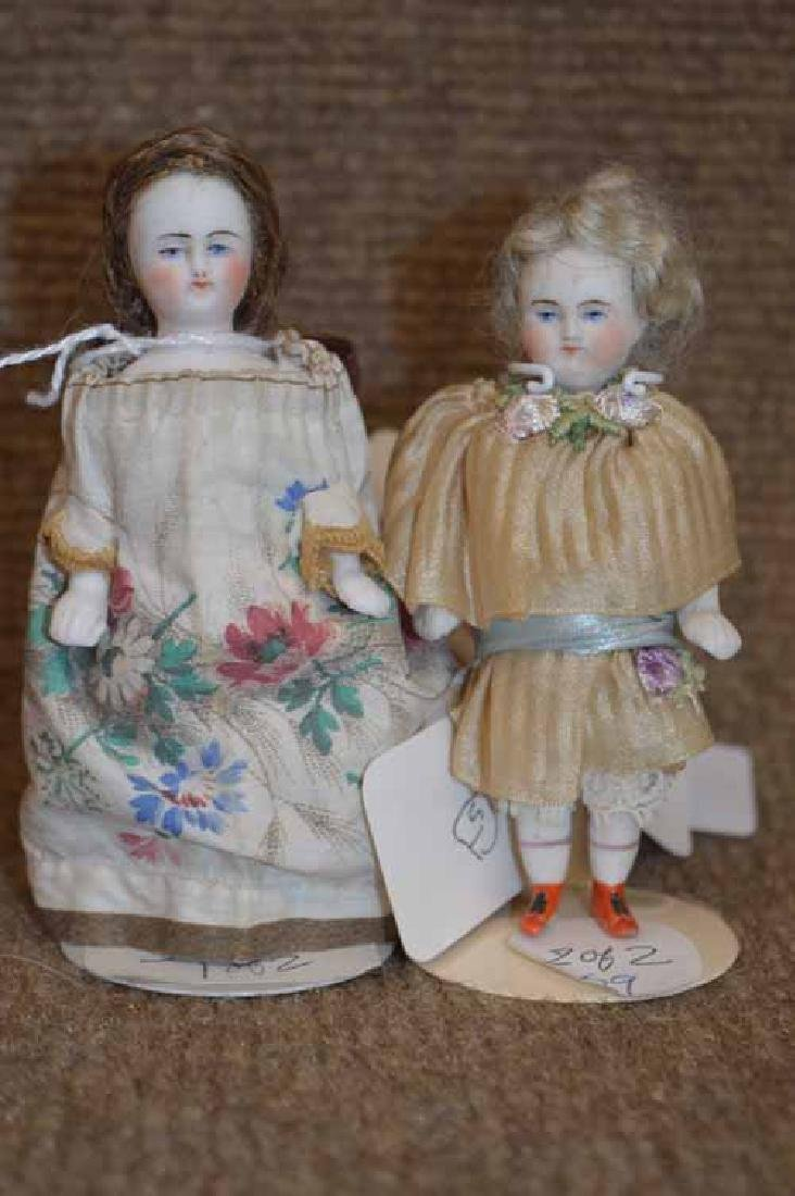 Two Parian All Bisque Dolls