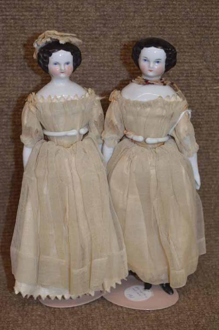 Pair of Flat Top Shoulder Head Twins.