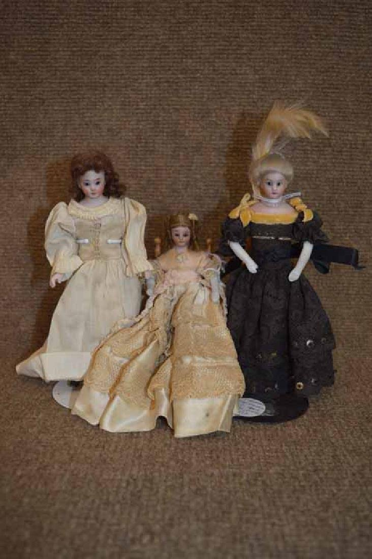 3 Small Bisque Lady Dolls