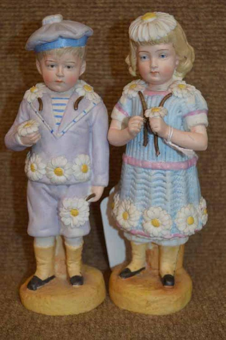 "Pr . Of 8"" Bisque Figurines"