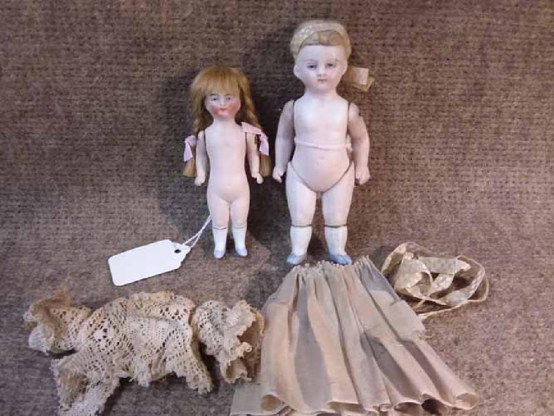 (2) All Bisque Dolls