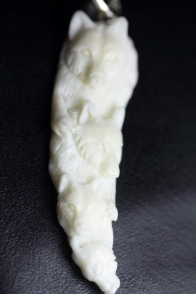 Hand Carved Bear Family Pendant
