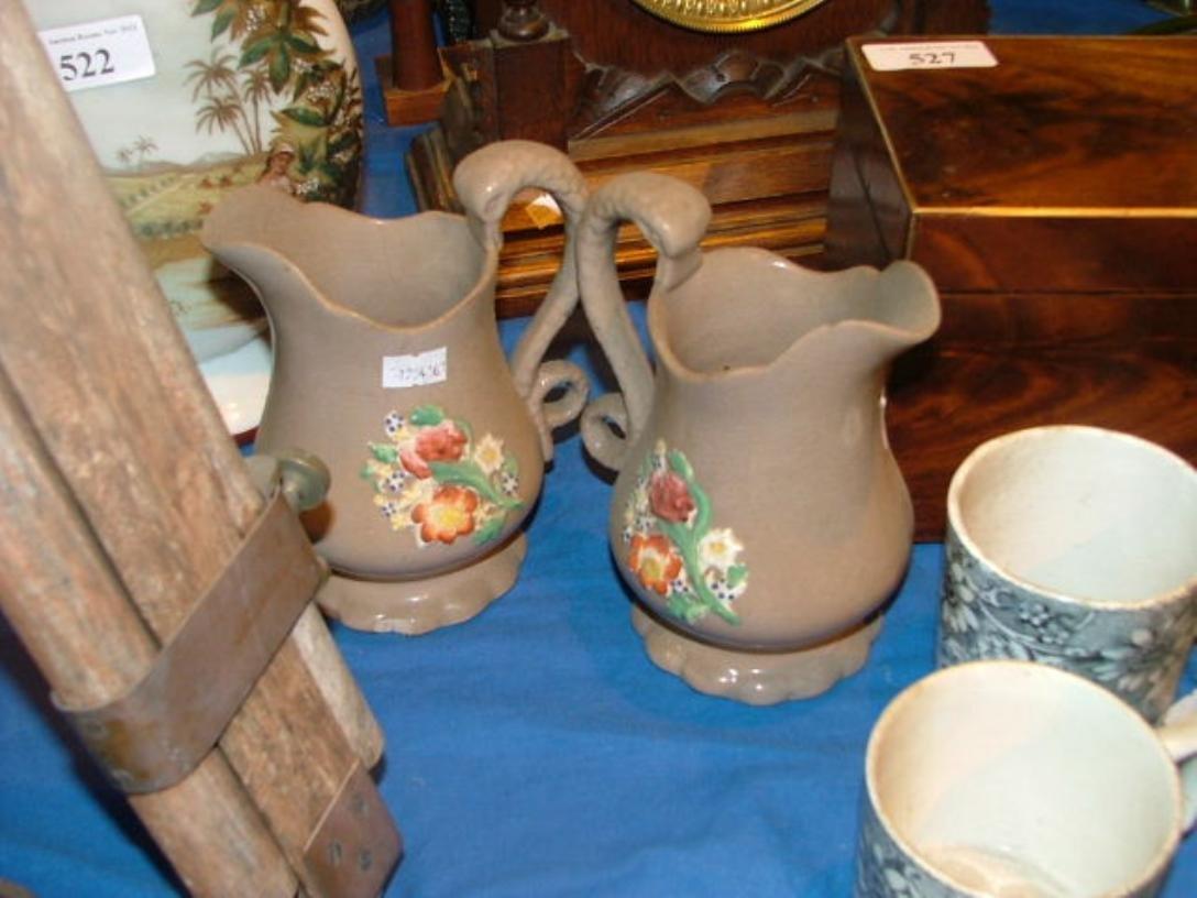 514: 2 dresser jugs Start bid €10