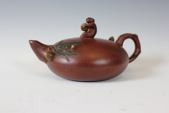 10: A DARK-RED ENAMELED POTTERY