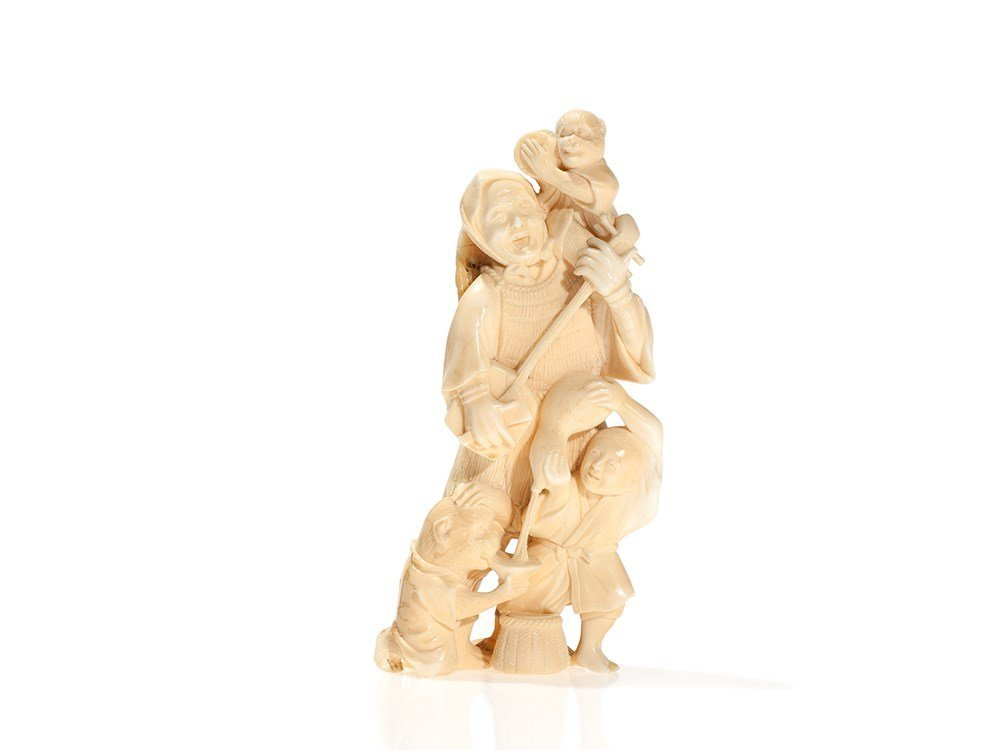 Ivory Okimono of a Musical Peasant Family with Monkeys,