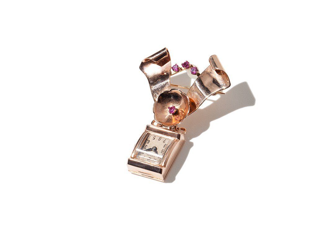 14 carat brooch with Girard Perregaux watch and rubies,