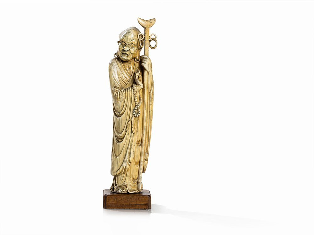 Ivory Figure of a Luohan with Long Stick and Prayer