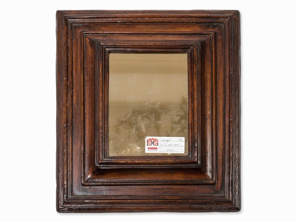 An Oak Moulded Cushion Mirror, Flemish