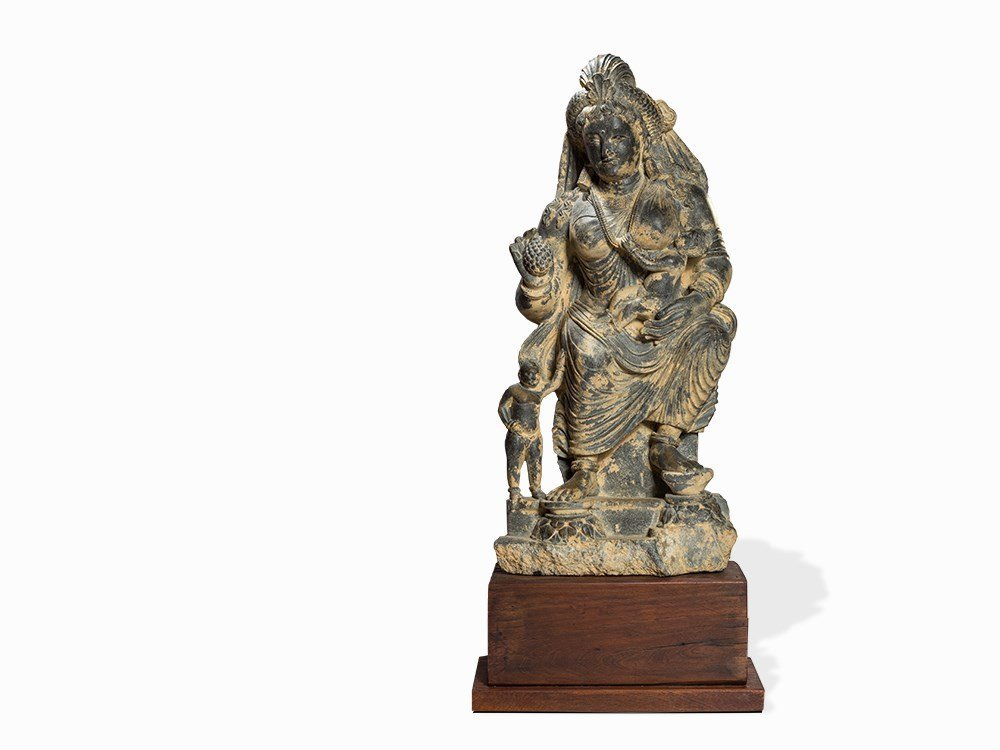 A Schist Figure of Seated Hariti with Children,