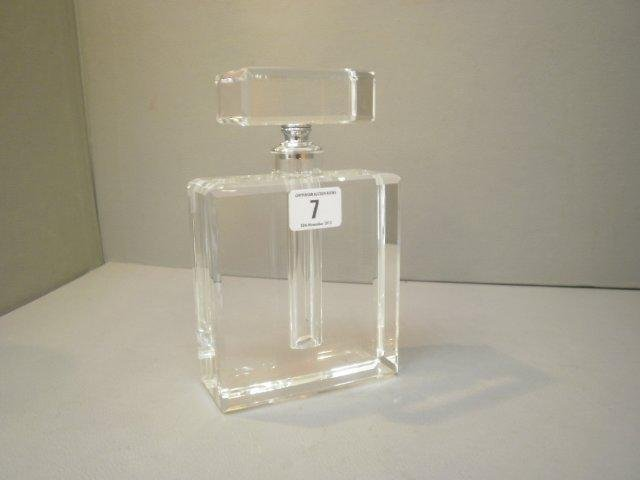 7: A large, Chanel style perfume bottle.