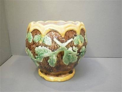 A 19th Century majolica jardiniere decorated with ac