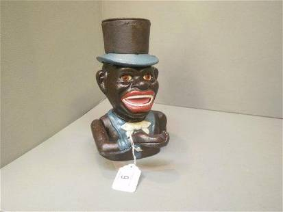 A cast metal money box in the form of a native Afric
