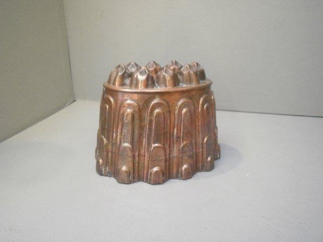 11: A Victorian copper jelly mould stamped H.L and Co.