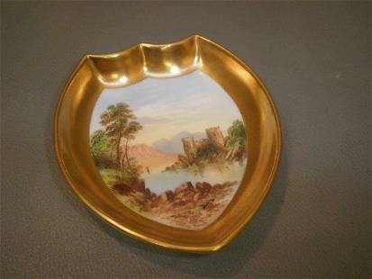 A Coalport shield shaped pin dish with handpainted