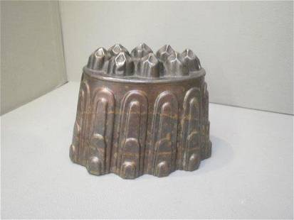 A Victorian copper jelly mould stamped HL and Co. 0
