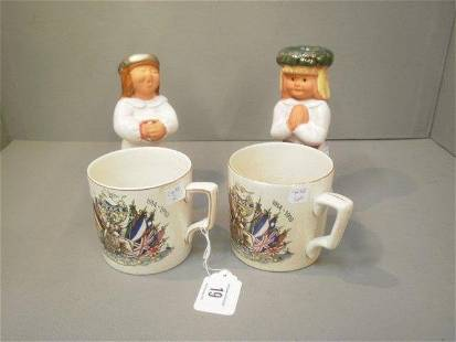 Two WWI 'Peace' commemorative mugs and a pair of Co