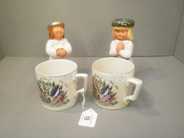 19: Two WWI 'Peace' commemorative mugs and a pair of Co