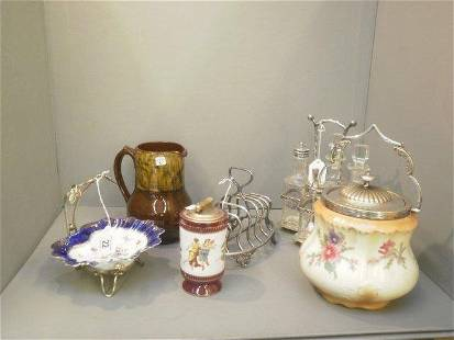 A silver plated and glass cruet set, toastrack and