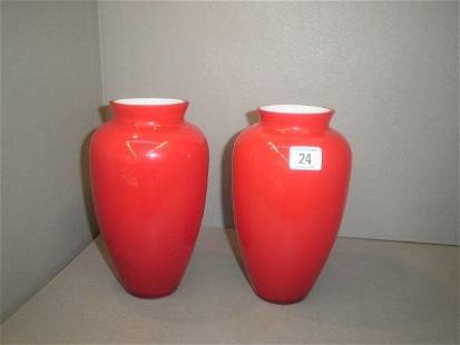 A pair of ruby glass vases.