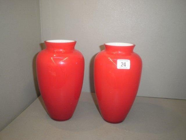 24: A pair of ruby glass vases.