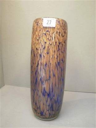 A tall blue and gilt decorated glass vase.