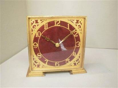 A four/five day brass cased mantle clock by Davall.