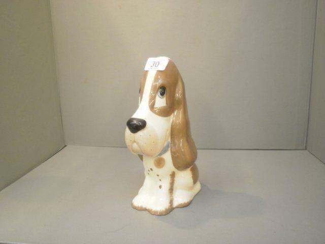 30: A large ceramic Szeuer seated dog.