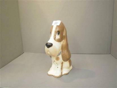 A large ceramic Szeuer seated dog.