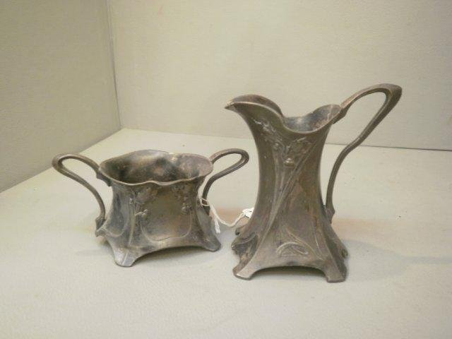 43: An Art Nouveau pewter WMF milk jug and sugar bowl.