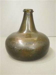 305: An 18th Century onion shaped wine bottle with stri