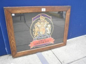 22: A framed and glazed Frys Chocolate crest, with orig