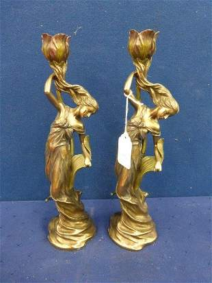 A pair of Art Deco style candlesticks in the form of